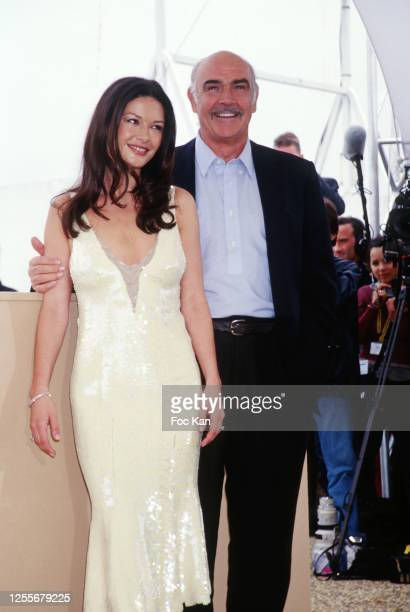 Catherine ZetaJones and Sean Connery attend the 52th Cannes Film Festival on May 1999 in Cannes France