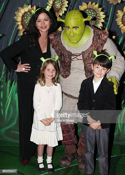 Catherine ZetaJones Brian d'Arcy James as Shrek Carys Zeta Douglas and Dylan Michael Douglas pose backstage at ShrekThe Musical on Broadway at the...