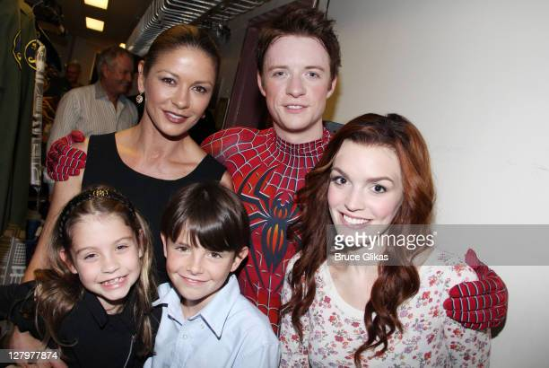 Catherine ZetaJones daughter Carys son Dylan Matthew James Thomas as SpiderMan and Jennifer Damiano as Mary Jane pose backstage at the hit musical...