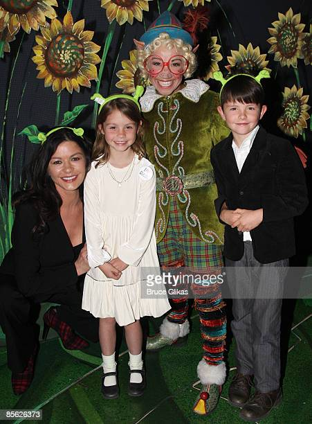 NEW YORK MARCH 21 Catherine ZetaJones Jen Cody as The Elf Carys Zeta Douglas and Dylan Michael Douglas pose backstage at ShrekThe Musical on Broadway...