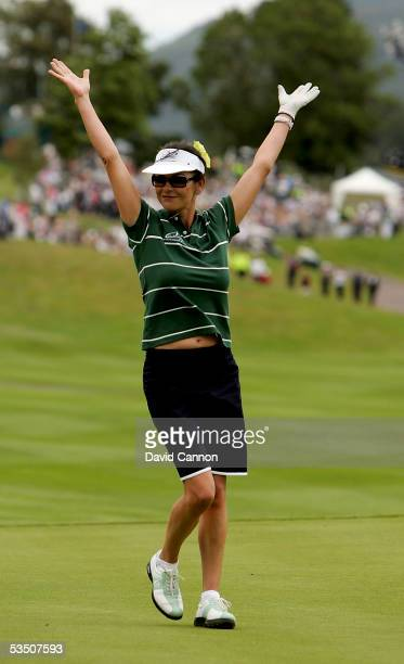 Catherine Zeta-Jones of Wales celebrates after holing a putt on the 1st green during the Monday fourball matches on the first day of All-Star Cup on...
