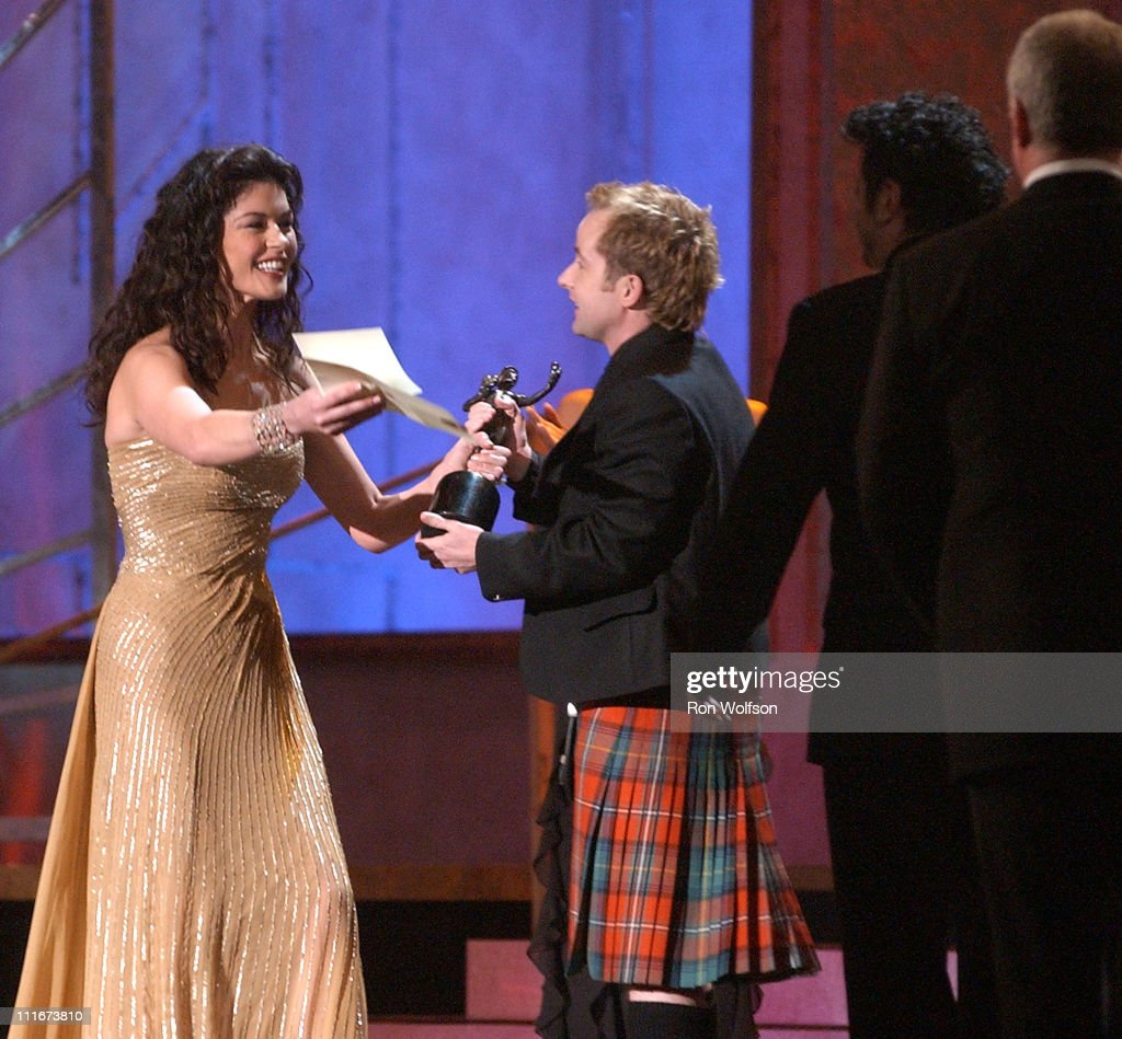 Catherine Zeta-Jones presents the Outstanding Cast in a Motion Picture Award to the cast of 'Lord of the Rings: Return of the King'