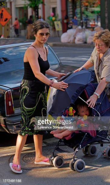 Catherine ZetaJones wife of Michael Douglas out for a stroll with son Dylan and nanny on Columbus Avenue near their home in NYC on June 25 2001...