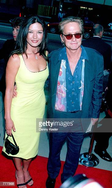 Catherine ZetaJones with Michael Douglas attend the premiere of 'The Muse' August 16 1999 in Beverly Hills Ca On August 8 the couple gave birth to a...