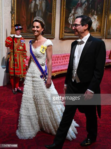 CatherineDuchess of Cambridge and United States Secretary of the Treasury Steven Mnuchin arrive through the East Gallery for a State Banquet at...