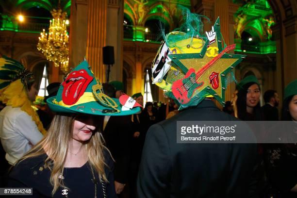 Catherinette and Nicolas of Chanel attend Maisons de Couture of Paris Celebrate SainteCatherine at Mairie de Paris on November 24 2017 in Paris France