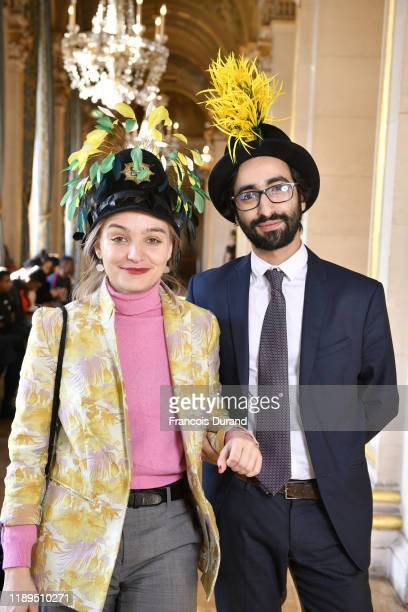 Catherinette and Nicolas pose during the Fete De la Sainte Catherine at Hotel de Ville on November 22, 2019 in Paris, France.