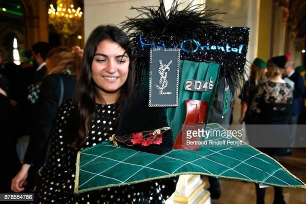 Catherinette of Yves SaintLaurent attends Maisons de Couture of Paris Celebrate SainteCatherine at Mairie de Paris on November 24 2017 in Paris France