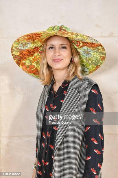 Catherinette pose during the Fete De la Sainte Catherine at Hotel de Ville on November 22, 2019 in Paris, France.