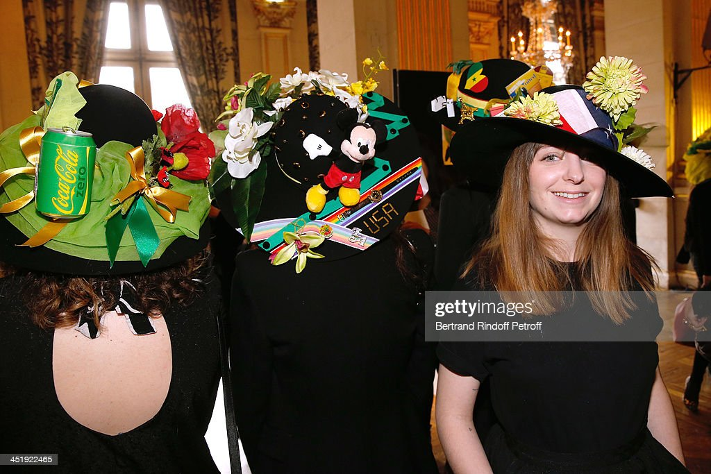 Catherinettes from Yves Saint Laurent attend Sainte-Catherine Celebration at Mairie de Paris on November 25, 2013 in Paris, France.
