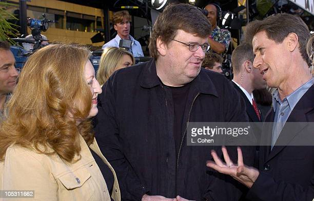 Cathleen Moore, producer, Michael Moore, writer/director/producer and Jon Feltheimer, CEO of Lions Gate
