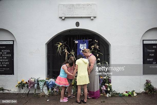 Cathleen Thomas leads a prayer with Kinlee Thomas Hannah Blystone and Caylee Thomas outside of Emanuel African Methodist Episcopal Church June 17...