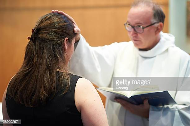 catholic adult baptism - baptism stock pictures, royalty-free photos & images