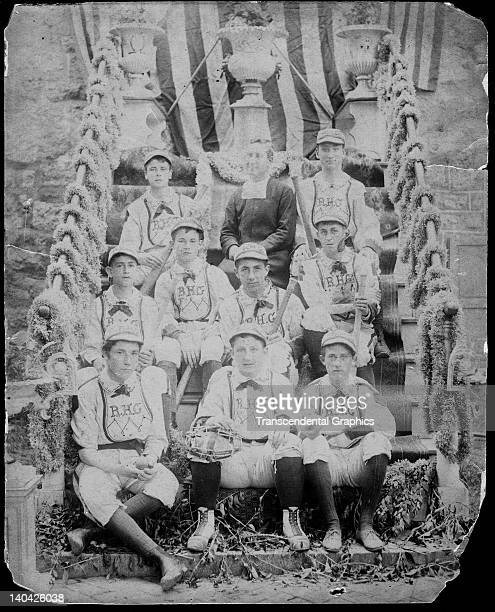 A catholic baseball team from an unknown location poses with their priest on a stairway in a photo made circa 1875