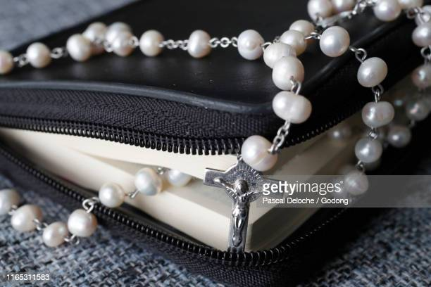 catholic bible with a rosary. - rosary beads stock pictures, royalty-free photos & images
