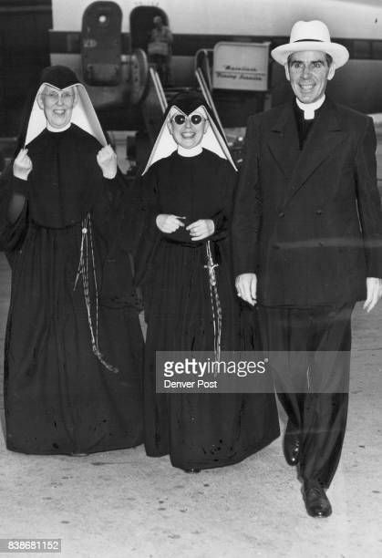Catholic Bishop Fulton J Sheen of New York is shown with Sister Frances Marie president of Loretto Heights college and Sister Marie Louise of the...
