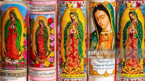 catholic candles for our lady of guadalupe - religious symbol stock pictures, royalty-free photos & images