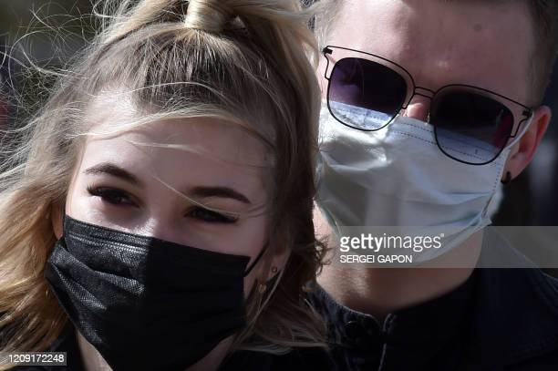 Catholic Christian believers wearing nose and mouth face masks amid concerns over the spread of the COVID19 the novel coronavirus attend the Sunday...