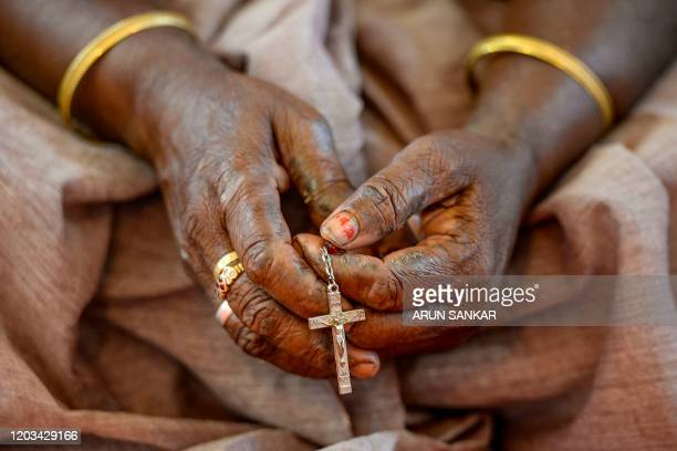 Catholic Christian devotee holding a rosary offers prayers during an Ash Wednesday service at St. Thomas Cathedral Basilica in Chennai on February...