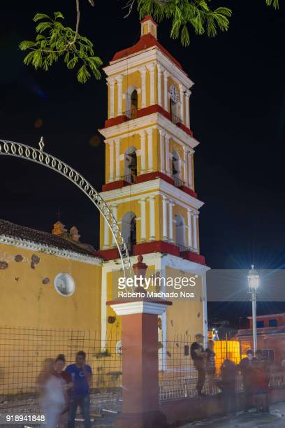 Catholic church bell and clock tower during 'Las Parrandas' or Christmas Festival The temple is named Saint John the Baptist and it is a colonial...