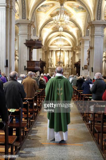 Catholic church during covid-19 epidemic. Celebration of the mass. Sallanches. France.
