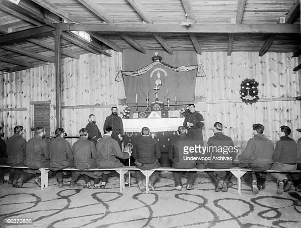 A Catholic church in the German Zussen prisoner of war camp with altar and captured Belgian soldier priests Zussen Belgium circa 1917