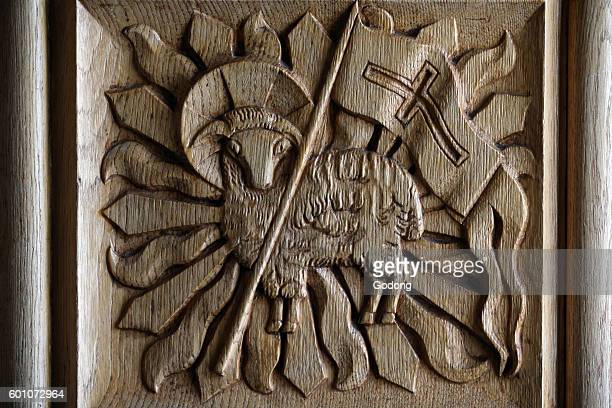 Catholic church of Finhaut in Valais canton Carved church door The lamb holding a Christian banner is a typical symbol for Agnus Dei Switzerland