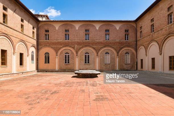 catholic church san clemente in santa maria dei servi, siena, tuscany - mauro tandoi stock photos and pictures