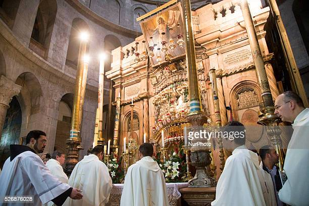 Catholic clergymen are pictured during the procession inside the Church of the Holy Sepulchre opening the celebration of the Holy Thursday mass in...