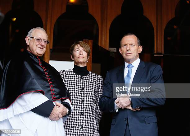 A catholic cleric Australian PM Tony Abbott and wife Margie after the memorial service for the victims of flight MH17 at St Mary's Cathedral on July...