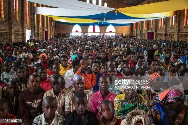 Catholic devotees attend Easter mass at La paroisse Saint Aloys d'Ijenda in Ijenda, Burundi, on April 4, 2021.