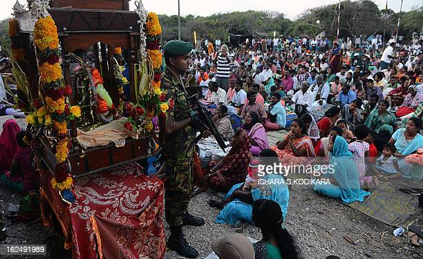Catholic devotees attend the annual pilgrimage at Saint Anthony's Church on Katchchativu Island in the northern waters of Jaffna on February 24 2013...