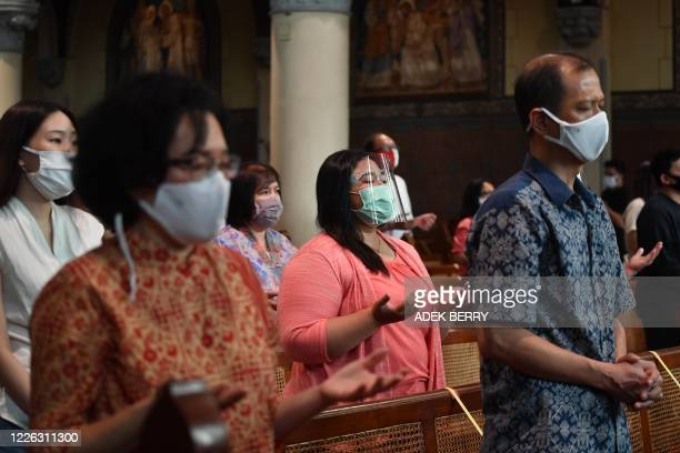 Catholic devotees attend the first mass prayers since a partial lockdown due to the COVID-19 coronavirus at Jakarta Cathedral in Jakarta on July 12,...