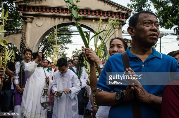 Catholic devotees attend the Palm Sunday mass in Immaculate Conception Cathedral Pasig City Philippines on 25 March 2018