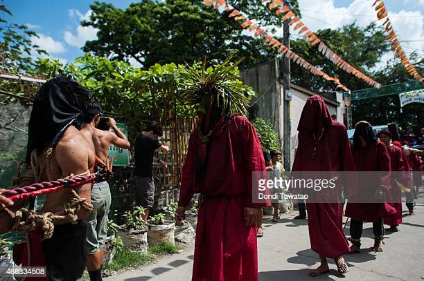 Catholic devotees flail themselves with wooden whips as a form of penance during holy week on April 2 2015 in Mabalacat Pampanga province Philippines...