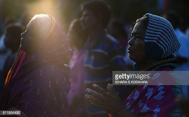Catholic devotees pray during the annual pilgrimage at Saint Anthony's Church on Katchchativu Island near Jaffna on February 21 2016 Roman Catholic...