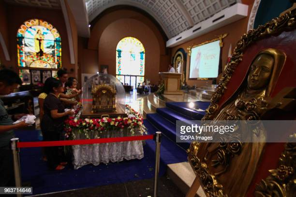 Catholic devotees seen touching the Shrine of Saint Therese of the Child Jesus in New Port City in Pasay Metro Manila for the veneration of the holy...