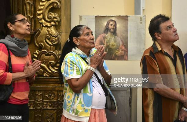 Catholic faithful attend an Ash Wednesday Mass as they begin the Lent observance at Tegucigalpa's Cathedral on February 26 2020
