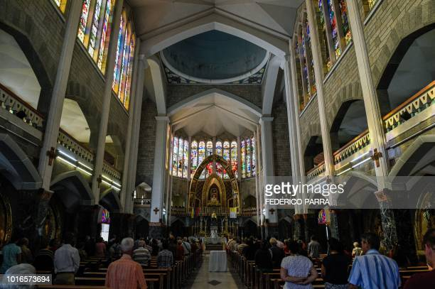 Catholic faithful attend mass at La Coromoto Church in Caracas on August 12 2018 The shortage of cash in the country has forced churches to accept...