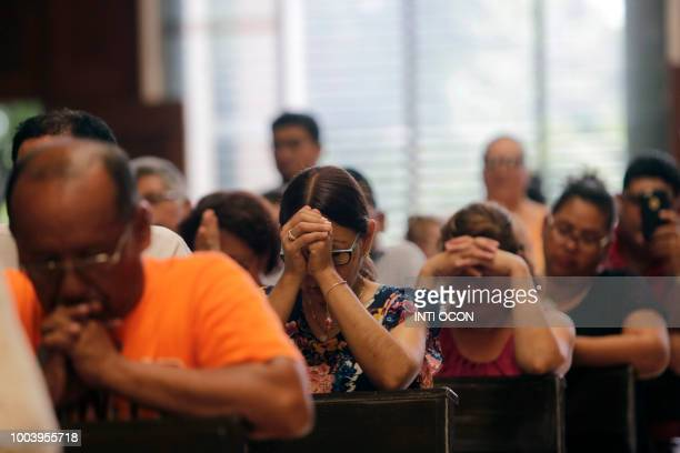 Catholic faithful attend mass at the 'San Miguel Arcangel' church in Managua on July 22 2018 The chances of talks finding a way out of Nicaragua's...