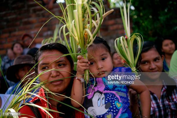 Catholic faithful attend the traditional Palm Sunday procession in Panchimalco 18 km south of San Salvador on April 14 2019 For Christians Palm...
