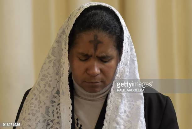A Catholic faithful attends the celebration of Ash Wednesday at Our Lady of Lourdes Sanctuary in Bogota on February 14 2018 Wednesday marks the...