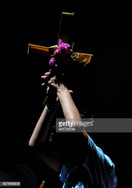 A Catholic faithful boy attends Palm Sunday mass at the Cathedral of Managua on March 25 2018 Palm Sunday marks the beginning of Holy Week for the...