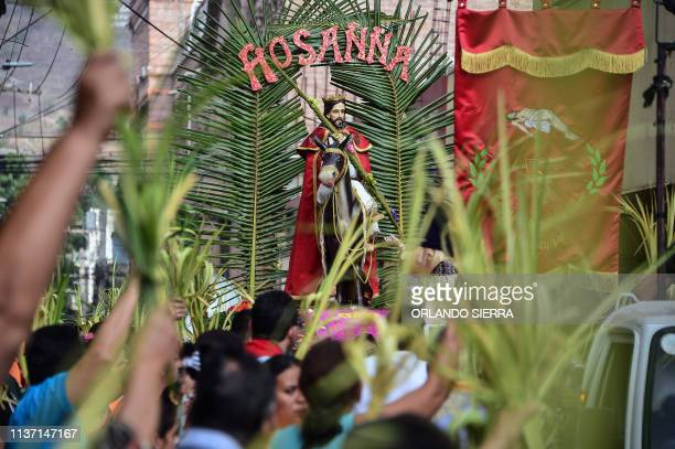 Catholic faithful carry an image of Jesus Christ during Palm Sunday procession in Tegucigalpa on April 14 2019 For Christians Palm Sunday marks the...