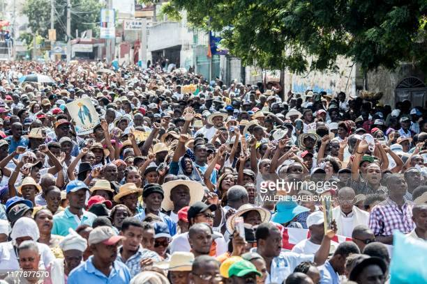 Catholic faithful demonstrate in a silent and non-violent march in Port-au-Prince against the Haitian government on October 22, 2019. - Thousands of...