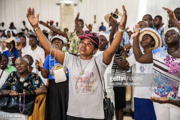 Catholic faithful gather at a church in Port-au-Prince before a silent and non-violent march against the Haitian government on October 22, 2019. -...