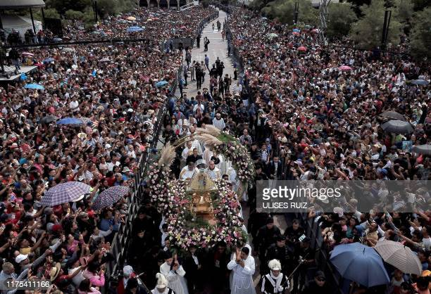 Catholic faithful gather to receive the image of the Virgin of Zapopan, during the annual pilgrimage to the Basilica of Zapopan, in Zapopan, state of...