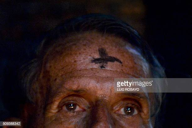 A Catholic faithful participates in a mass for Ash Wednesday on February 10 in Cali Colombia Ash Wednesday marks the beginning of Lent a period of...
