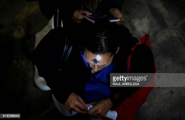 A Catholic faithful participates in the celebration of Ash Wednesday at Our Lady of Lourdes Sanctuary in Bogota on February 14 2018 Wednesday marks...