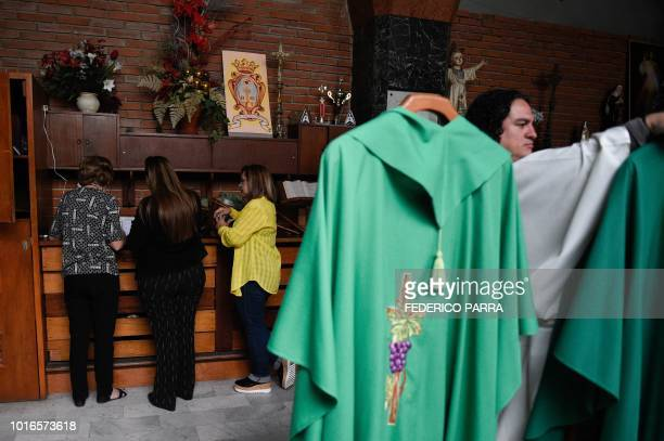 Catholic faithful pay the tithe with debit card after mass at La Coromoto Church in Caracas on August 12 2018 The shortage of cash in the country has...